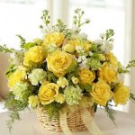same day flower delivery - yellow roses in a basket arrangement