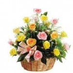 Yellow And Pink Roses In A Basket